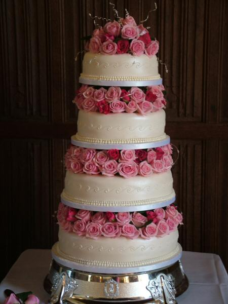 Pink wedding cake from leatherwooddesign.com. Theme wedding ideas and weddings by color scheme